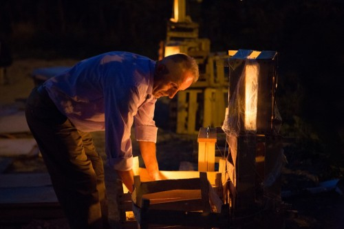 Ahmet Bey lights candles. Photo by Kristina Williamson